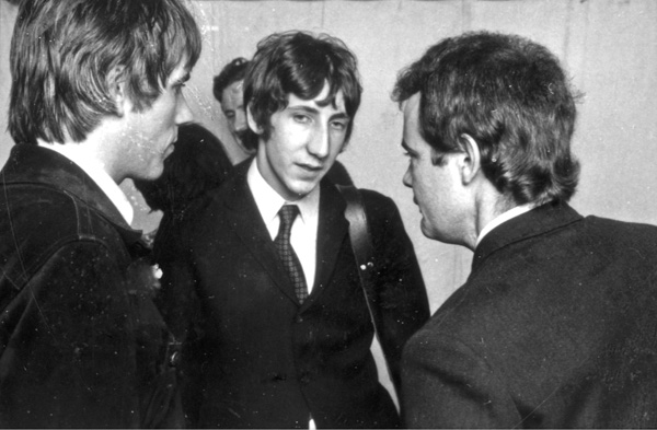 Chris Stamp at left. Pete Townshend, and Kit Lambert at Windsor Jazz Festival in 1966 (Sony Pictures Classics)
