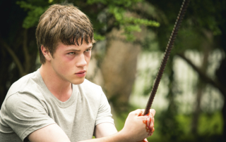 Oscar (Connor Jessup) holding a bloody piece of rebar in Closet Monster (Strand Releasing)