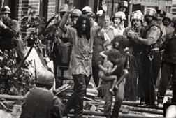 MOVE members emerging from their headquarters during a 1978 confrontation (Sam Psoras)