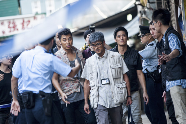 Aaron Kwok, center, in Port of Call (Film Society of Lincoln Center)
