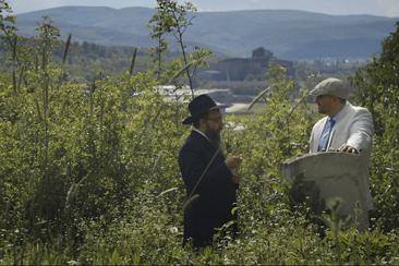 Rabbi Boruch Oberlander and Csanad Szegedi in a Jewish cemetery in Keep Quiet (Marton Vizkelety)