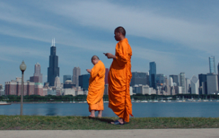 Monks tweeting in Lo and Behold, Reveries of the Connected World (Magnolia Pictures)